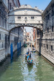 Gondola and canal. VENICE, ITALY - JUNE 30, 2008: Gondola full of tourists on canal Royalty Free Stock Image