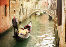 Gondola on canal in Venice. Gondola travels down the canals of Venice in Italy Stock Photography