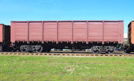 Gondola car. Rail freight open wagon with high sides Royalty Free Stock Images