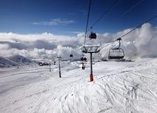 Gondola and chair lift at ski resort Royalty Free Stock Images
