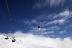 Gondola and chair-lifts at ski resort in nice day Royalty Free Stock Images