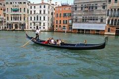 Gondola. A gondola cruising on river in beautiful Venice royalty free stock photos