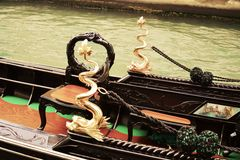 Gondola details in vintage hues, Venice, Italy. Beautiful and romantic cityscape, historical buildings and bridges, gondola details in vintage hues, Venice royalty free stock images