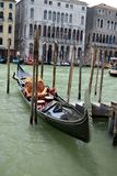 Gondola docked on the Grand Canal in Venice Stock Image