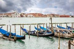 Gondola docked in venice Stock Photos
