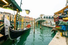 Gondola with famous Rialto bridge cross grand canal, Venice, Ita Stock Photos