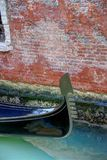 Gondola Ferro. Close up of the bow of a gondola with its ferro against a red brick background Royalty Free Stock Photo