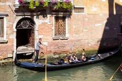 Gondola floats along the old canal in Venice, Italy Royalty Free Stock Photography