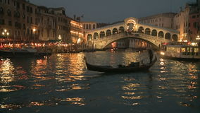 Gondola in front of Rialto Bridge in Venice stock video