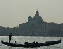 Gondola and Giudecca. Gondola with gondolier in venice italy Royalty Free Stock Photography