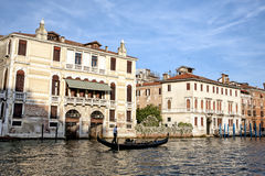 Gondola on golden waters of Grand Canal in Venice Royalty Free Stock Image
