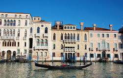 Gondola with gondolier on the Grand Canal. Venice, Italy Royalty Free Stock Image