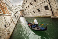 Gondola with gondolier and tourists on the canal Royalty Free Stock Image