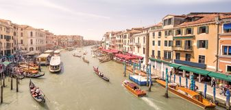 Gondola with gondolier and vaporetto station Stock Photography