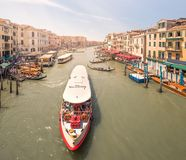 Gondola with gondolier and vaporetto station Royalty Free Stock Photos