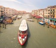Gondola with gondolier and vaporetto station Royalty Free Stock Photos