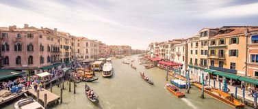 Gondola with gondolier and vaporetto station Royalty Free Stock Photo