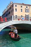 Gondola and gondolier in Venice Royalty Free Stock Photo