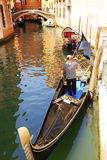 Gondola with Gondolier in Venice, Italy Stock Image