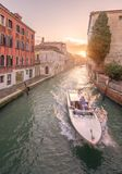 Gondola with gondolier in Venice, Italy Royalty Free Stock Photo