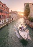 Gondola with gondolier in Venice, Italy. Gondola with gondolier in Venice channel, Italy Royalty Free Stock Photo