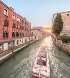 Gondola with gondolier in Venice, Italy. Gondola with gondolier in Venice channel, Italy Royalty Free Stock Images