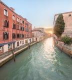 Gondola with gondolier in Venice, Italy. Gondola with gondolier in Venice channel, Italy Stock Photo