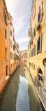Gondola with gondolier in Venice, Italy. Gondola with gondolier in Venice channel, Italy Royalty Free Stock Image