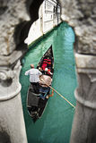 Gondola with gondolier in Venice, Italy Stock Images