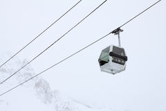Gondola Lift. Empty cable car with a mountain in the background Royalty Free Stock Photo