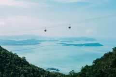 Gondola lift above sea Royalty Free Stock Photo