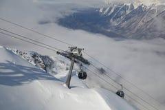 Gondola Lift Against Mountain Range Stock Photo