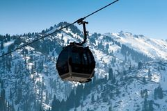 Gondola lift (cable car). Ski-lift against a wintery background Stock Photo