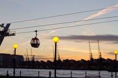 Gondola lift in London. Gondola lift over Thames in London UK in the evening stock image