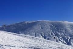 Gondola lift and off-piste slope Royalty Free Stock Image