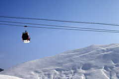 Gondola lift and off-piste slope at sun morning Stock Photo