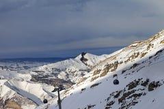 Gondola lift on ski resort at sun evening Stock Image