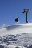 Gondola lift on ski resort at windy sun day Stock Images