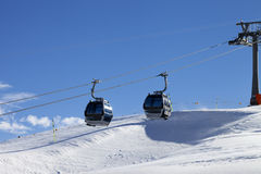 Gondola lift on ski resort at windy sun day Stock Photo