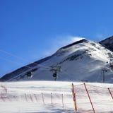 Gondola lift on ski resort at windy winter day Royalty Free Stock Photography