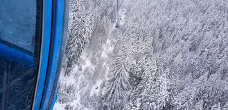 Gondola lift at ski resort in winter. Pirin Mountains. stock photos