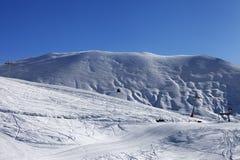 Gondola lift and ski slope Stock Photo