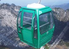 Gondola lift on snowy mountain Royalty Free Stock Images