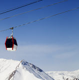 Gondola lift and snowy mountains Royalty Free Stock Photo