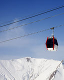 Gondola lift and snowy mountains Stock Photo