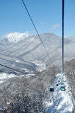 Gondola lift in winter mountines Stock Photo