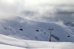 Gondola lifts and off-piste slope in mist Royalty Free Stock Photos