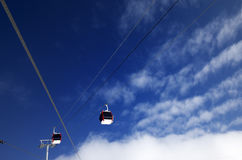 Gondola lifts at ski resort and blue sky with clouds in nice day Stock Photos