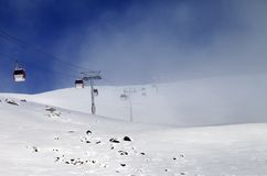 Gondola lifts and ski slope in mist Royalty Free Stock Photos