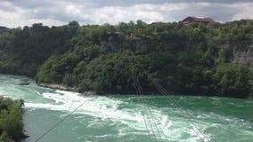 Gondola line over river. Gondola cable line crossing deep river gorge in Ontario Canada stock video footage